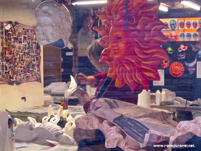 Venetian artisan decorating masks
